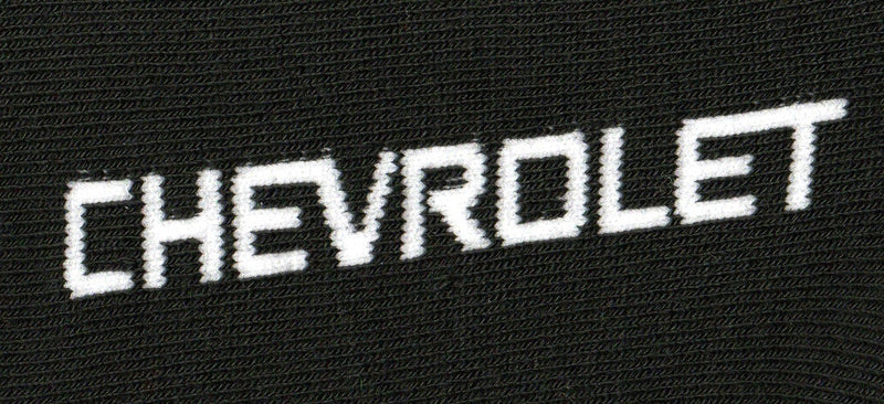 Close up of the knitted word of Chevrolet on the foot.