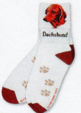The Dachshund Head on the Crew side and the Word Dachshund appears on the Anklet side of the Cuff. Russet Heels and Toes blend with the Dachshund's head colors and Light Tan paws over the foot of Bright White background.