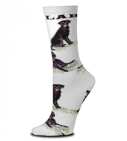 "For Bare Feet Black Lab Poses Sock starts on a Bright White background.  Under the Cuff reads, ""LAB"" in Black Bold Print. After that are Black Labs in Poses all the way down to the Toes. All the Poses are on top of Green Grass. The Labs are Black and Dark Grey and Medium Grey for Shading and Highlights. The Eyes are Grey and Black and the Mouth is Rose. The Poses are Sitting and Laying Down."