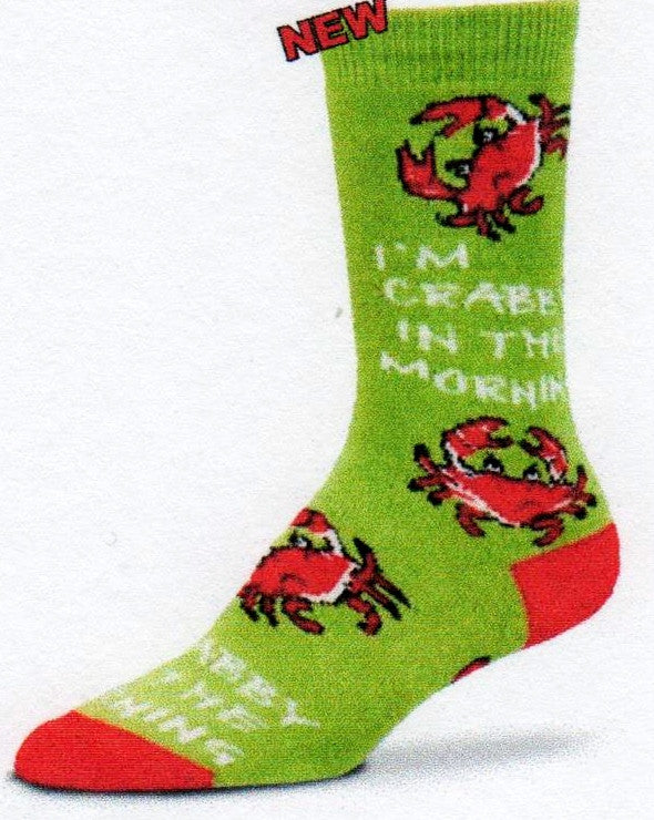 "On an Avocado background FBF designed Crabby Morning with Red, Black and White Crabs saying all over the Sock ""I'm Crabby In The Morning""."