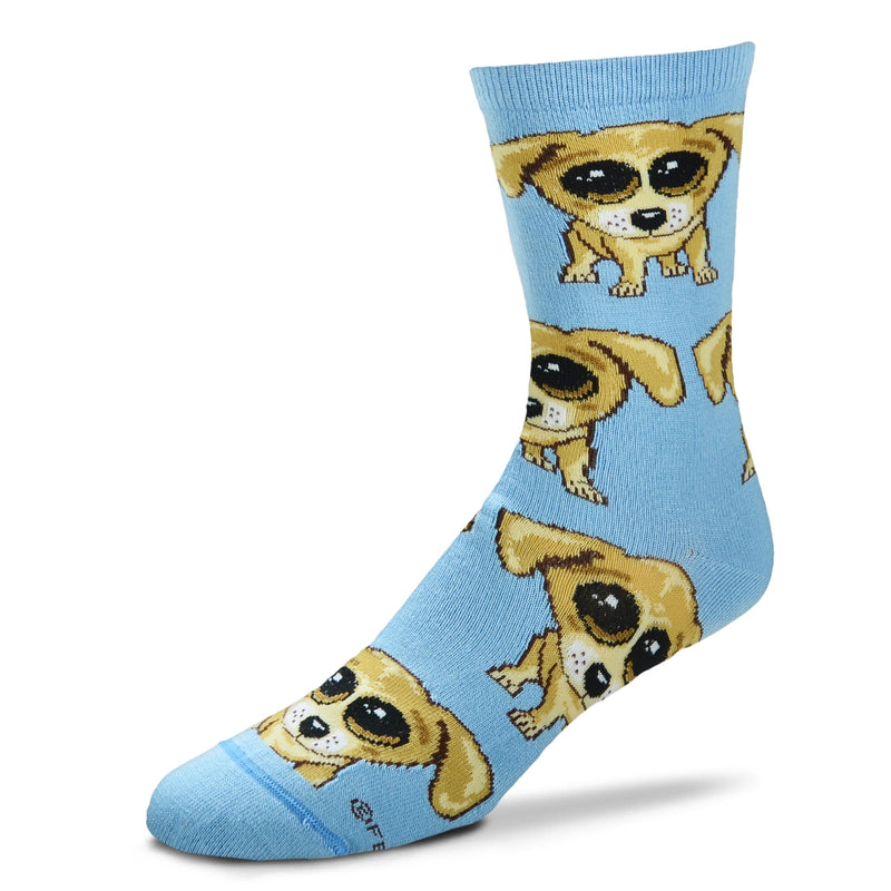For Bare Feet Dogs Jumbo Eyes Sock starts on a Light Blue background. The Dogs have Jumbo Black and White Eyes. The Dogs are Colors of Browns, Camel, Buff, and Seal Brown.