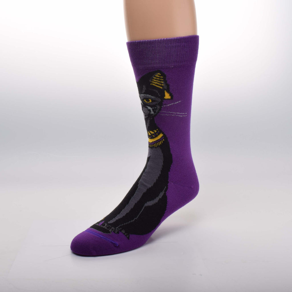 For Bare Feet Egyptian Cat Sock starts on a Purple background with a Beautiful Black Cat staring at you with Amber Eyes. She has Gold jewelry on her head and neck and around her foot.