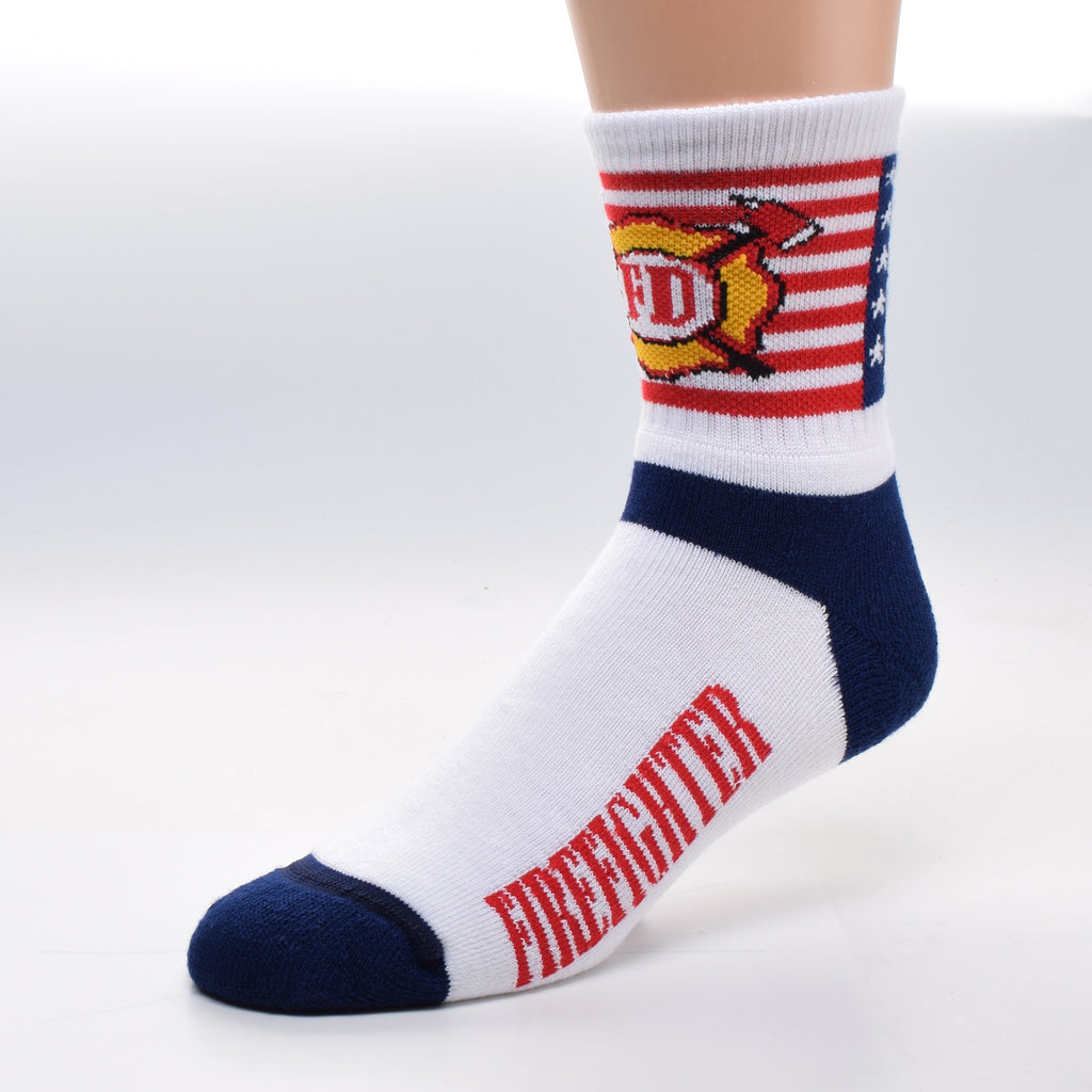 For Bare Feet Firefighter Flag Cuff Sock is an American Flag on the Cuff with a Firefighter Badge superimposed on top. The Foot of the Sock has Navy Blue Heels and Toes and Red Firefighter reads on both sides in a field of White.