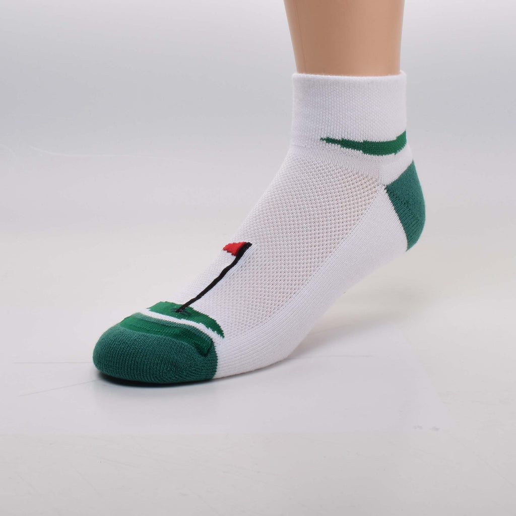 For Bare Feet Golf Sock is a Sport Sock for Men. It is all White background with Green Heels and Toes. The Soles are Cushioned. The 2 inch Cuff has a Tee Box with a Red Tee a White Golf Ball and Green Grass. On Top of the Foot is a Woven Light Weight material that allows air and moisture to flow. It also has the Green a Hole and a Pin that is Black with a Red Flag.