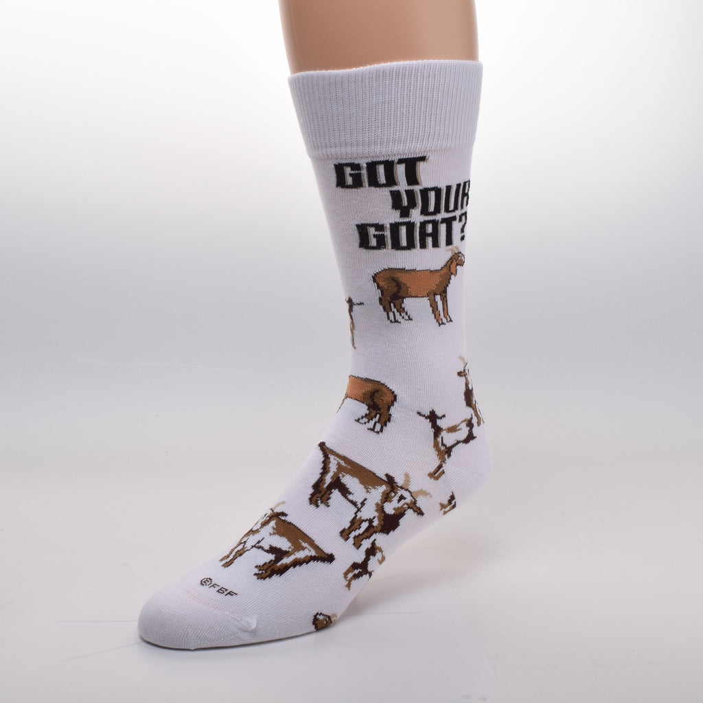 "For Bare Feet Got Your Goat Sock starts on a Bright White background. In Bold Black print reads, ""Got Your Goat?"".  There are Goats and Kids all over the Sock. Colors are Browns, Rust, Russet, Camel and more with White and Black."