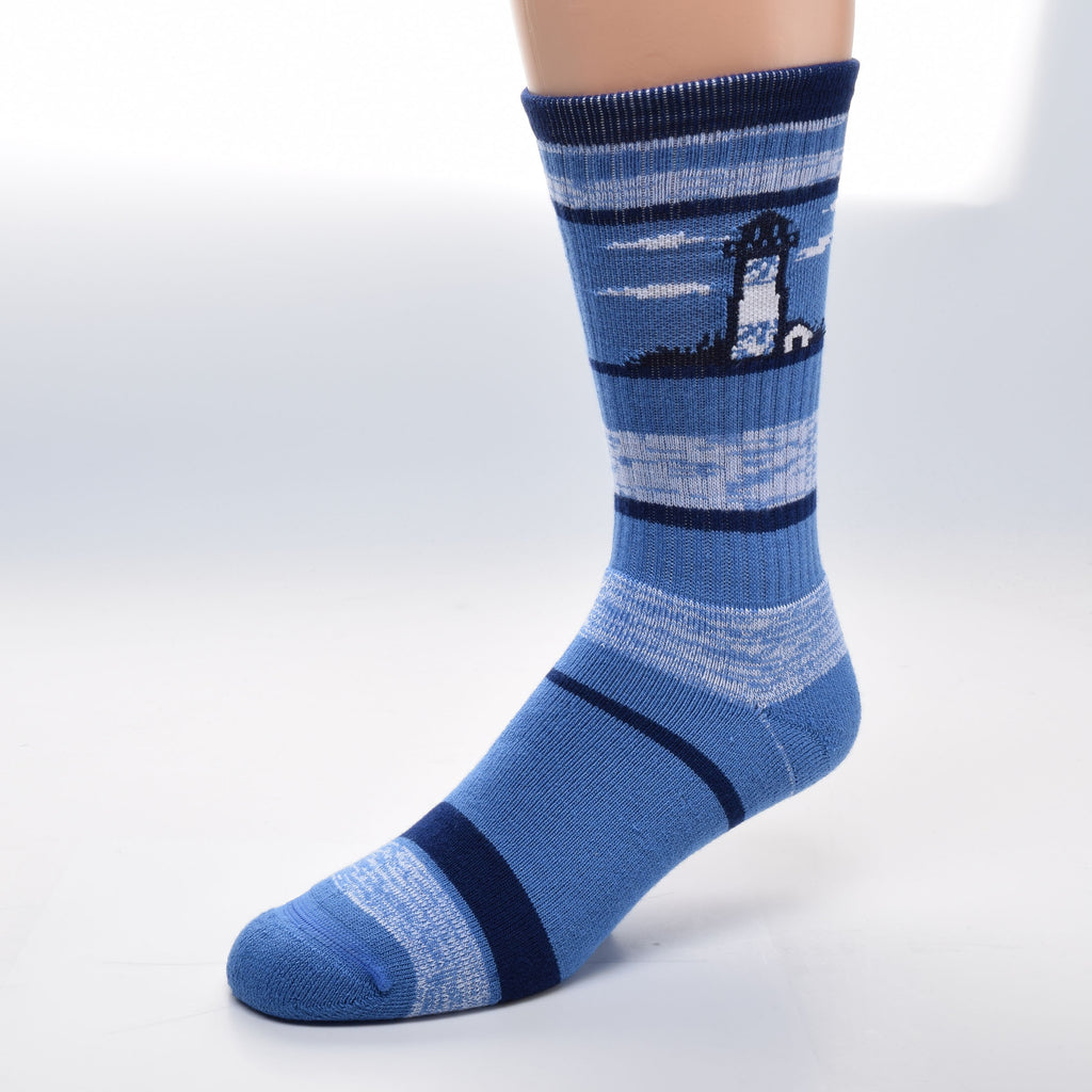 For Bare Feet Lighthouse RMC Stripe Sock is made on a background of Blue. Navy Blue Stripes some are large or narrow. The RMC (random mixed color) stripe is one made with Blue and White in random order. The Lighthouse is mostly White with a little Blue on top and bottom. The Top of the the Lighthouse and the outlining of it and the Lightkeepers House is Navy. The Clouds and the House are White.