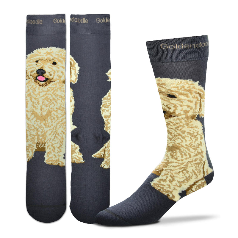 FBF Realistic Goldendoodle Sock starts on a Charcoal background. In the middle of the 2 inch Cuff is the word Goldendoodle in Buff. The Goldendoodle sits on Top of your Foot and around to your Heel. His coat is Flax and Buff with Russet for shadow and outline. Black for Eyes Nose and Mouth. One Tone Rose for Tongue.