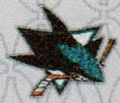 San Jose Sharks Logo showing shark biting a Hockey Stick in half.