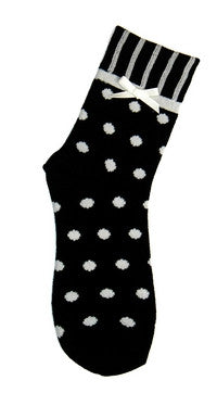 Foot Traffic Bow Tie Polka Dot Black Sock has Ivory Dots all over the Sock. The Heels and Toes are Black. The Cuff is Vertical Rows of Black and Ivory. Below the Cuff is a Bow Tie in Ivory.