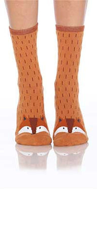 Foot Traffic Fox Slipper Sock starts with a background color of Rust. The Dark Brown are fur changes in color. On the Soles of the Sock are White Rubber Non-Skid Dots. The Fox's Face is at the Top of the Toe. It is Rust and has a White Mask with a Sienna Forehead and a Dark Brown Nose Line that ends with a Black Nose. The Eyes and inside Ears are also Black.