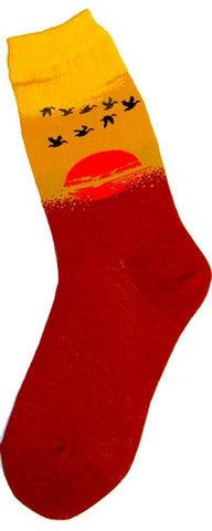 Foot Traffic Sunset Sock starts at the Toe to just above the Heel is a Russet Brown.Then you see the Orange as the Sun, it is diffused with Russet Brown dots and Khaki Dots. Khaki is the next color. Then a Pumpkin and last is Bright Orange-Yellow. Flying are Black Silhouettes of Geese.