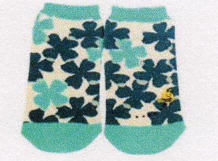 Just a Little Mismatched one with a Bee and one Clover Sock without.