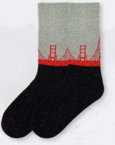 K Bell American Made Golden Gate Bridge Sock starts with Grey for Fog. The the Golden Gate Bridge spans across the Sock in Red. Then comes solid Black like the San Francisco Bay at Night.