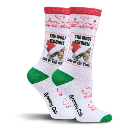"Grumpy Cat is wearing a Red and White Santa Hat and says, ""It is the Most Terrible Time of the Year"". Well maybe it is for him This Sock has all the standard Christmas Green and Red colors for fun."