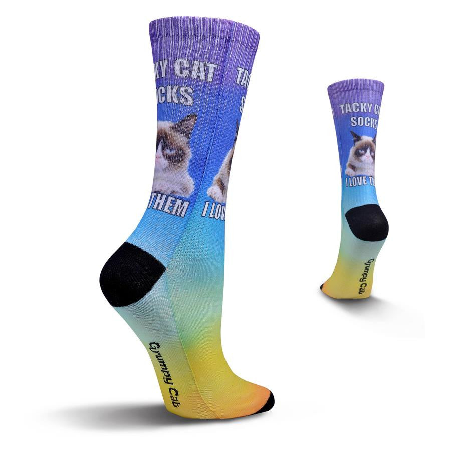 "Grumpy Cat Womens Tacky Cat Sock begins with Black Toes and Heels. Then the Colors of the Rainbow start from the Toes going up the sock to the Cuffs. In the middle of the Ankle is Grumpy Cat and the Words above and below him read, ""Tacky Cat Socks I Love Them"""