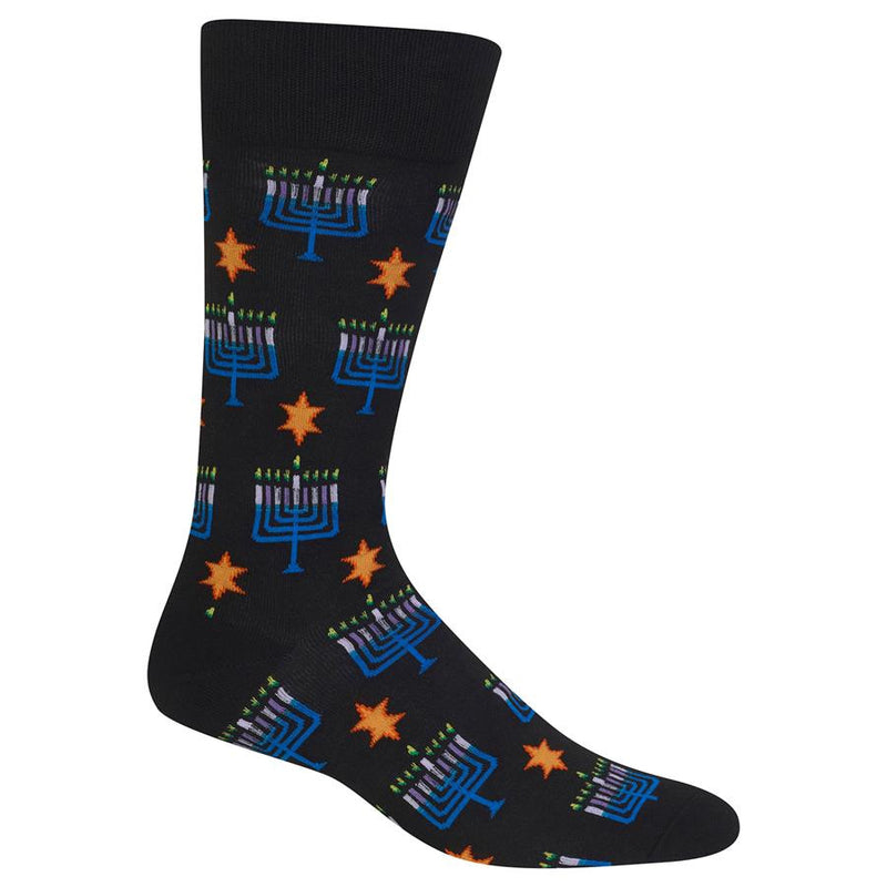 The Hot Sox Mens Menorah Sock shows the Celebration of Hanukkah in all the days lit up on the Menorah. The Sock is a Black background with an Orange Star. The Menorahs are Yellow with Green Flame. The Candles are Lilac and Lavender. The Menorah is Teal and True Blue.