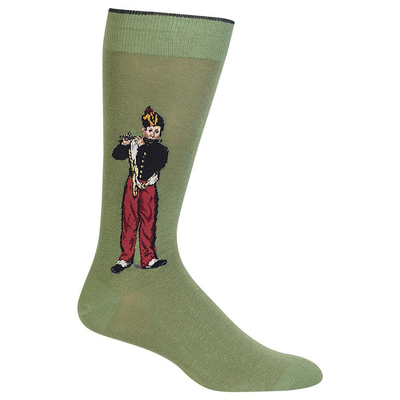 Hot Sox The Fifer Sock is in the Great Artist Sock Collection and begins with a Moss Green background. The Fifer is a Boy dressed in a Black Coat, Red Pants and Black Shoes. He is standing playing his Coal Fife.