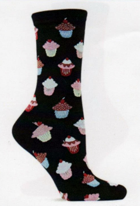 Hot Sox Womens Cupcake Socks start on Black background with Colored Paper Cups in different shades and Icing in White, Pink and Chocolate with a Cherry on Top.