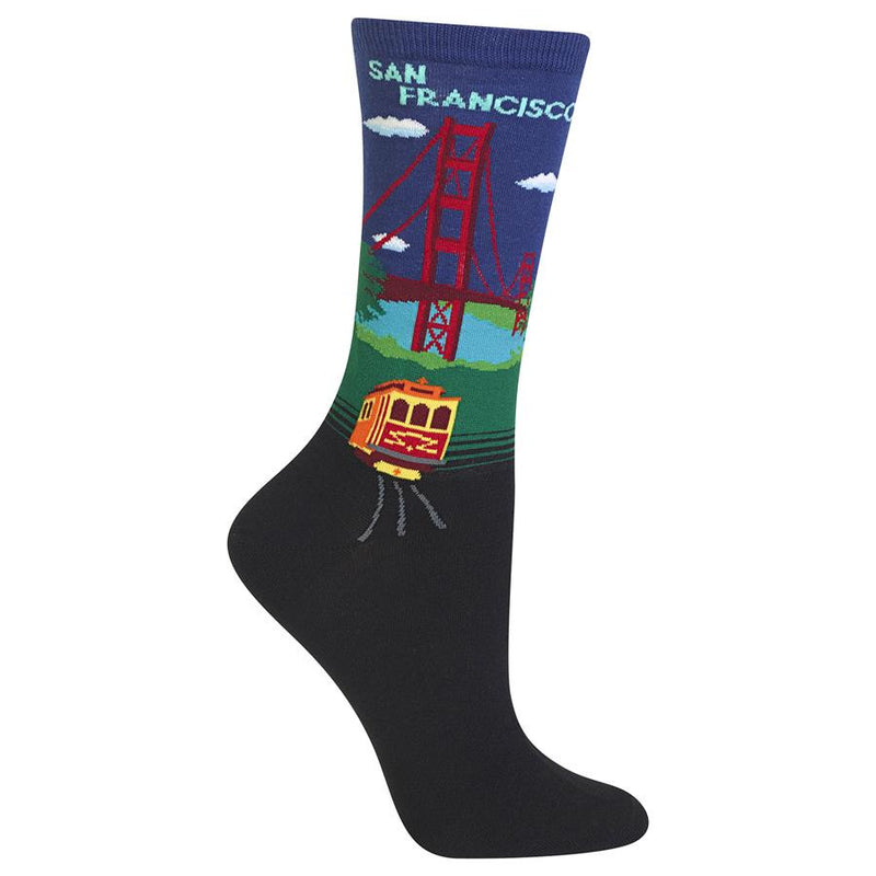 "Hot Sox Womens Golden Gate Bridge Sock shows the Golden Gate Bridge the words, ""San Francisco"" and has a Cable Car on Tracks. This is in Royal Blue."