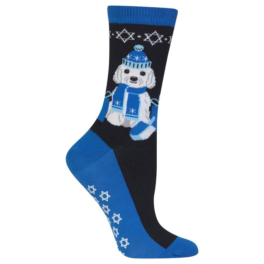 Hot Sox Womens Dreidel Dog Non-Skid Sock is Black and Blue backgrounds. The Cuffs, Heels, Soles and Toes are all Blue. There are White Star of David along the sole of the feet which are Non-Skid decoration. The Dog is White with Grey Details. The Eyes, Nose and Mouth are Black. The Knit Hat and Scarf with packages are all Blue and Light Blue. The Dreidel is Blue, Light Blue and White.