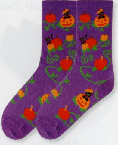 Pumpkin Patch Cats starts on Bright Purple with Pumpkins in Dark Orange and Jack-O-Lanterns in Light Orange and a Kitty popping out of it!