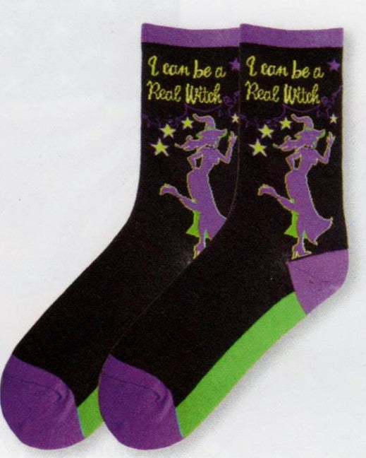 Ah ... Halloween can make any women a Witch! In this Sock she is a Real Witch in Purple, Bright Green and Black.