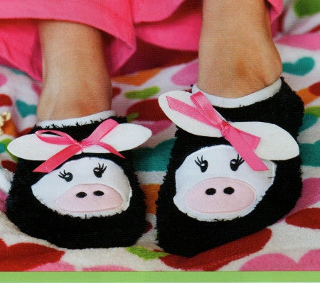 K Bell Black Cow Slipper Socks are Black all over with Cozy fuzzy 100% Polyester yarn. White band that stretches to let your feet inside. Cute Cow Face with White Ears and Pink Bow.