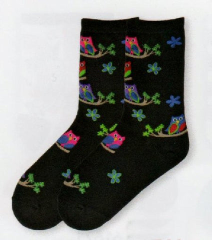 K Bell Colorful Owls Novelty Socks are on a Black background with brightly colored Owls of Green,Denim, Maroon and Purple.