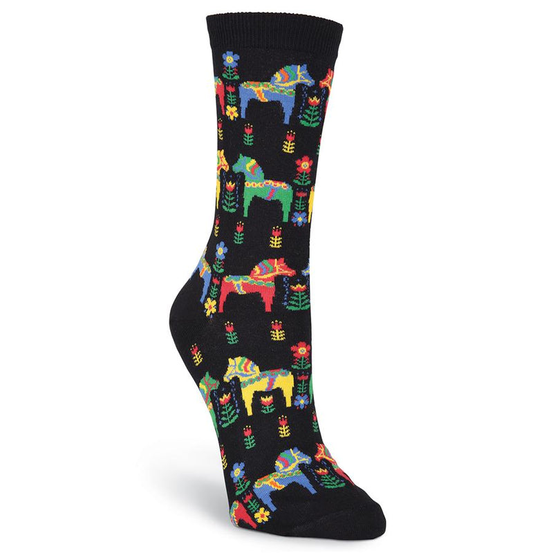 K Bell Womens Danish Horses starts on an all Black background. The Dala Horses are Red, Green, Yellow and Blue. They are decorated with the same colors for Manes, Reins and Flowers on the Horses. Wooden Flowers are in Rows in the same colors on the Sock.