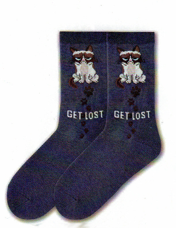 "Grumpy Cat Womens Get Lost Sock starts on a background of Denim Heather. Grumpy Cat is a full body on this Sock. In Cream, Tan Brown and Chocolate. His Eyes are Blue and Nose is Pink. Under him are the words, ""Get Lost"". They are in White Bold Print. Chocolate Paw Prints are shown starting through Get Lost up to Grumpy Cat."