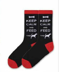 K Bell Keep Calm and Feed The Dog Sock is a Meme to the Keep Calm sayings of the world. It starts with a Black background with Bright Red Cuffs, Heels and Toes. Keep Calm and Feed the Dog is written in Bold White Print. The Dog is a Silhouette in White.