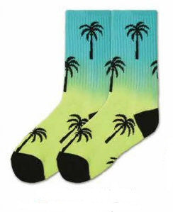 K Bell Kids Palm Crew Sock starts on a Rainbow background of Blues to Greens. The Heels and Toes are Black. The Palm Trees are Silhouettes in Black.