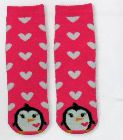 K Bell Kids Penguin Tube Non Skid Slipper Socks starts with an all Pink background with White Hearts all over. The Penguin is at the Toe made in Black and White with a Pink Heart.  His Nose and Feet are Orange