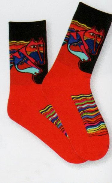 Wind Spirit is the Name of this Laurel Burch Sock and it is all about the Horses' Manes. In Black the Horses Heads are Running with the Manes following long trails behind in Rainbows of color.