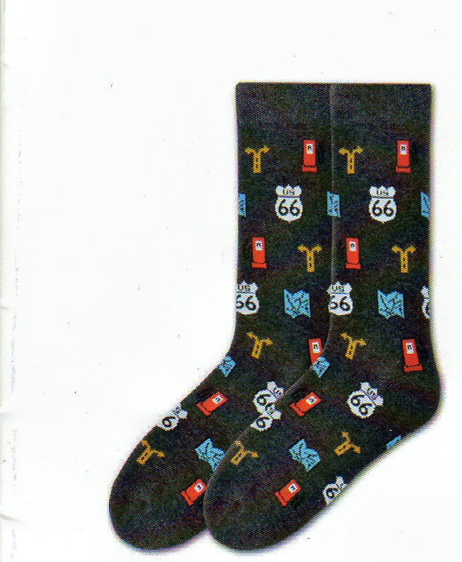 K Bell American Made Mens Route 66 Sock starts off with a Black Heather background. Then has Graphics of Route 66 US Sign in White and Black, Red Gas Pump, Blue Map to help you drive and a Yellow Road Sign for a Left or Right Turn.