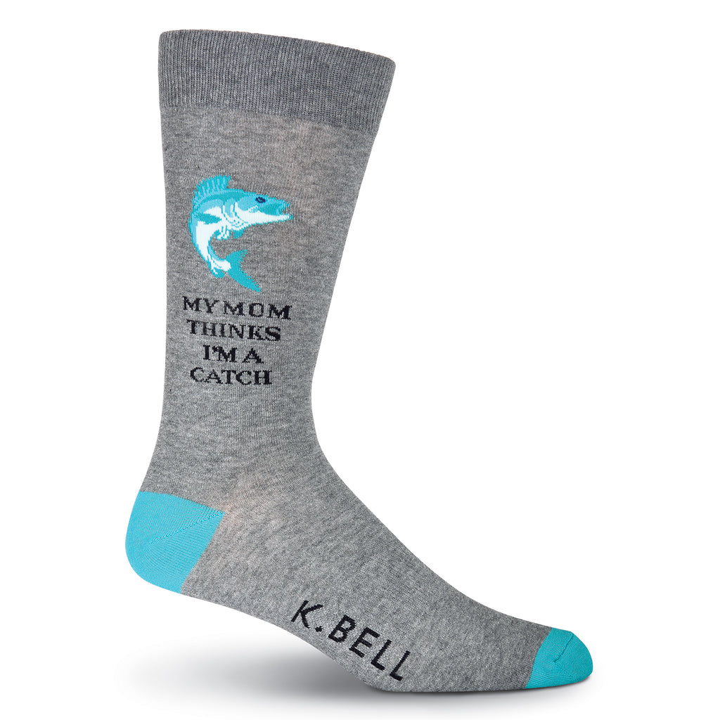 "K Bell Mens I'm A Catch Sock begins on a Charcoal Grey background with Viridian Heels and Toes. The Fish Graphic is made with Viridian, Teal and Aquamarine. The words are in Bold Black print that reads, ""My Mom Thinks I'm A Catch""."