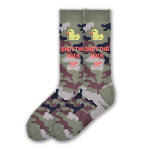 "On a Camouflage background you see a Little Rubber Ducky at the top of the sock. Below in Bright Red Letters reads, ""Shut the Duck Up""."