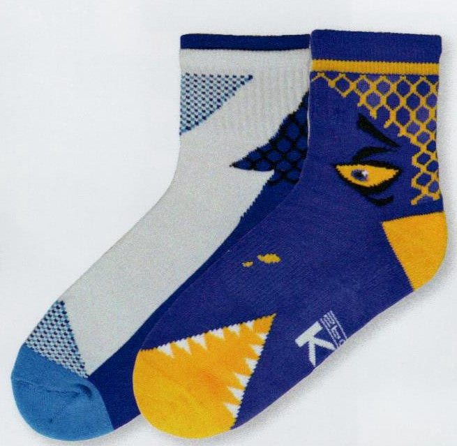 K Bell Mens Monster Bite Hi Top Crew Sock 2 Pair Pack is Lapis and Bright Yellow with a monster eye and mouth. The second pair continues the long monster with shades of Lapis White and Light Blue