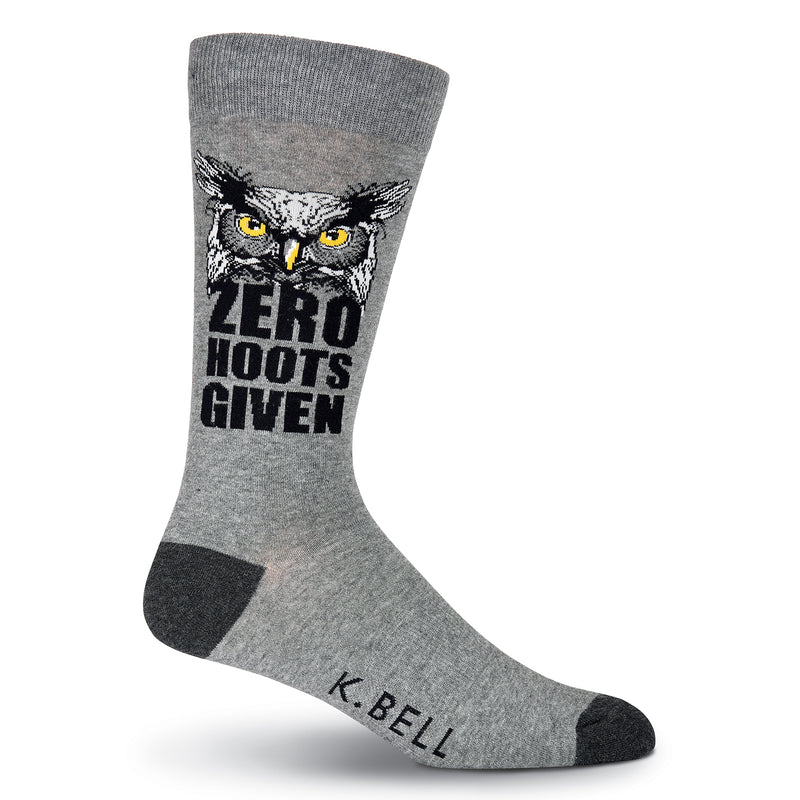 "K Bell Mens Zero Hoots Given Sock is a Meme. It starts with Charcoal Heather background and Black Heels and Toes. The Graphic Owl is Dark Grey, Light Grey, Black and Yellow for the Owl's Eyes and Beak. ""Zero Hoots Given"" is in Bold Black below the Owl."
