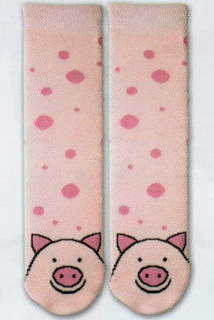 K Bell Tubular Pig Slipper Sock is a Bright Pink Tube background with Rose Pink small and large dots all over. At the Toes and foot of Sock is a Happy Pig with Rose Ears and Nose. Black outlines the Eyes Nose and a smile.