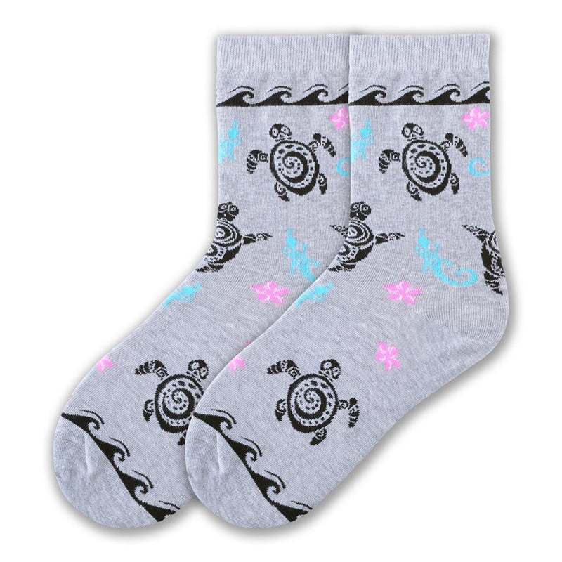 K Bell Tribal Turtles Socks start out of Heather Grey background. Black Tribal Turtle Graphics and all over the Sock. Wave Graphic below the Cuff and above the Toes shows off Water.  Also on the Sock are Graphics of a Lizard and Starfish Flowers.