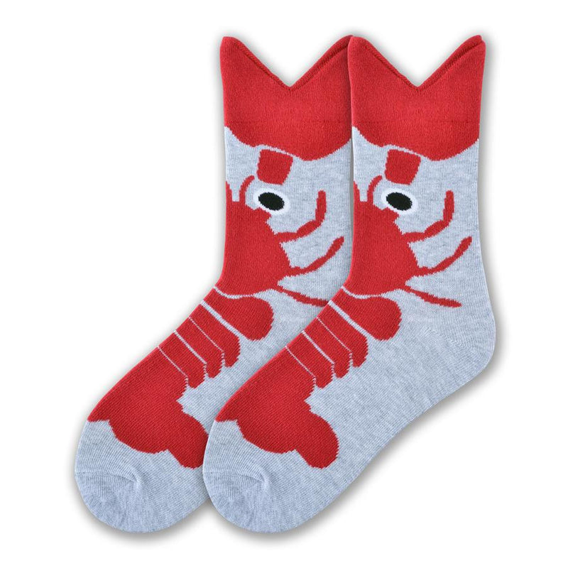 K Bell Womens Wide Mouth Lobster Sock starts on a Heather Grey background. The Body of the Lobster starts with the tail at the Toes. The Lobster is Maroon in Color. The Eyes are Black and White. The Wide Mouth is not the Mouth of the Lobster It is one of the Large Claws.