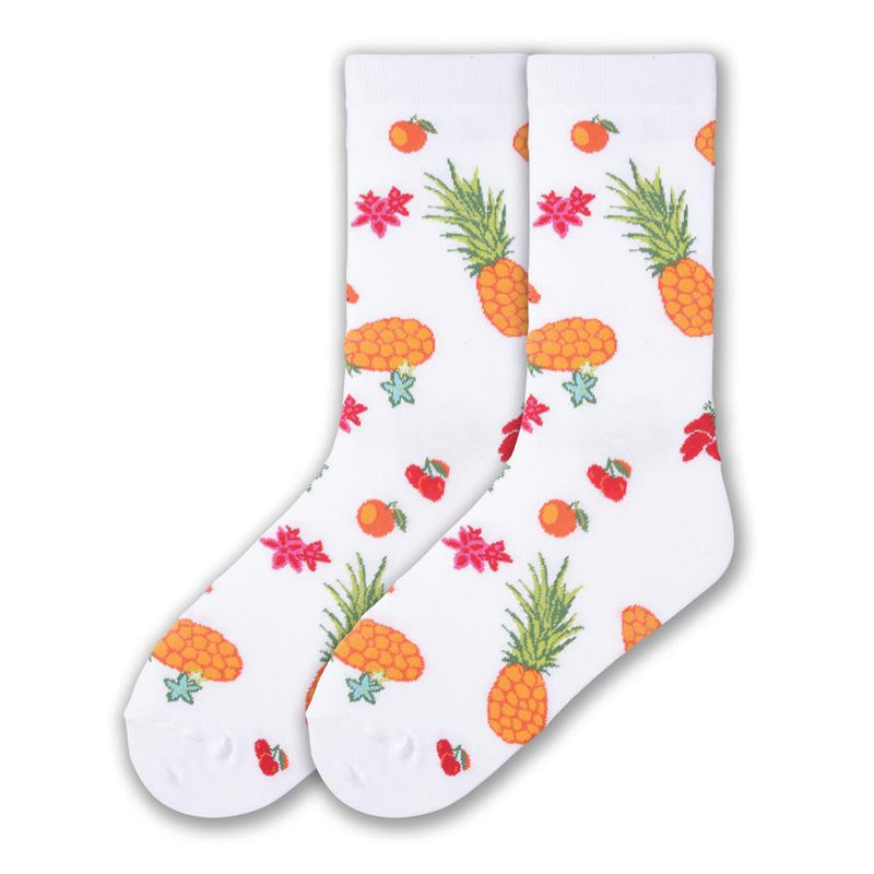 K Bell Tutti Fruitti Sock begins on a White background with colors of Bananas, Pineapples, Cherries, Oranges and Flowers of Orange, Red and Blue.
