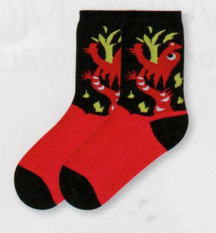 K Bell Kids Dragon Sock starts with Black background Heels and Toes. The Dragon is Crimson Red with Dark Khaki Flames coming from his Maroon Mouth. Black and White make his Eyes.