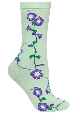Wheel House Design Morning Glories Sock starts out on a Mint Green background. The Morning Glories run from right under the Cuff to the Toe. It is a Green Vine with Green Leaves. The Morning Glories are Purple with Black to separate Leaves. The inner Flower is Grey, White and Yellow.