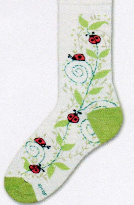 FBF Ladybug Swirls Socks are on a Bright White background with a Green Vine. The Red and Black Ladybugs are all around the vine. Looks like Spring and Country.