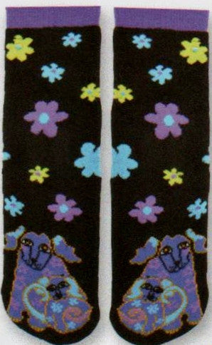 Laurel Burch Dog and Doggie Slipper Sock starts with a Black Background. It has Flowers of Blue, Purple and Lime Green Flowers. On the Top of the Toes are the Dog and Doggie in Purples. Non-Skid Rubber on the bottom finishes the cozy and warm sock.