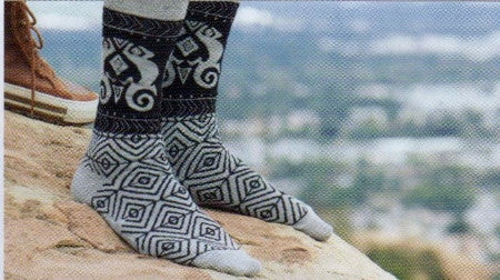 Laurel Burch Mens Lizard Socks are Black and Grey. They have Geometric Designs on the Foot. The Ankle has Black background with Tribal Lizards Designs.