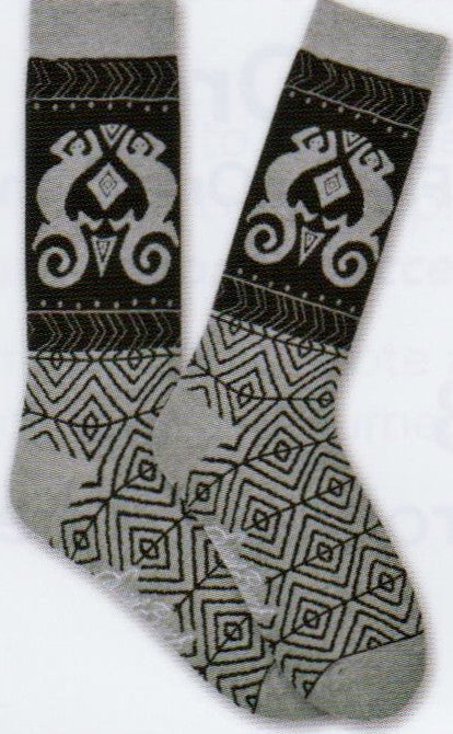 Laurel Burch Mens Lizard Socks are Black background where the Lizard is. It is a Tribal Looking Lizard. The Foot is designed with Geometric Diamond patterns.
