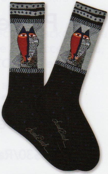 Laurel Burch Mens Native Cat Sock is Black with Dots at the foot and the Welt is the Cat face looking like a Native Mask. One Side all Red the other side is Black with symbols.